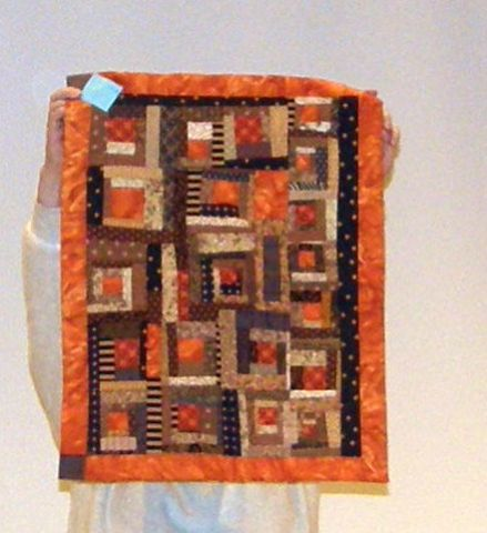 Marilyn Lutzker-Orange Log Cabin