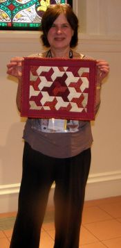 Jane Adler-Marjorie Rice's 90th Birthday Quilt-a small red and white tessellation