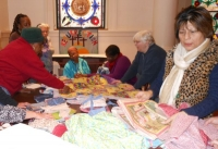 Members examining Fabric donations for Charity Quilts