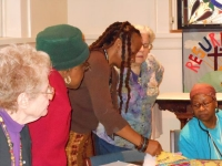 Members discussing Charity Quilts