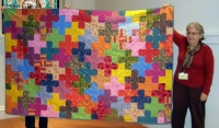 Tina Barth-Criss Crossed-Charity coach and chat quilt designed by the group