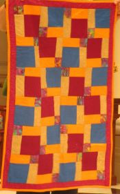 Orange and Red Charity Quilt